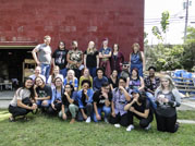 Group photo of students and chaperones at the ceramics studio of Susan DeMay